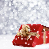 Red Christmas gift with falling snowflakes Royalty Free Stock Photography