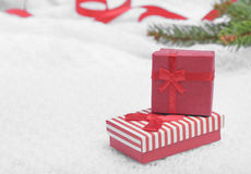 Red Christmas gift. Red Christmas present on white background with Christmas tree and red ribbon stock photos