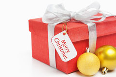 Red Christmas gift with tag Stock Images