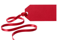 Red Christmas gift tag or label with ribbon Royalty Free Stock Photo