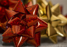Red christmas gift wrapping bow. Close up on a red christmas gift bow Royalty Free Stock Image
