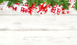 Red Christmas gifts green pine tree branches wooden background royalty free stock images