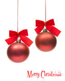 Red christmas globes. Two isolated christmas globe with red ribbons Stock Photography