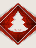 Red christmas greeting with bursting christmas tree Stock Images