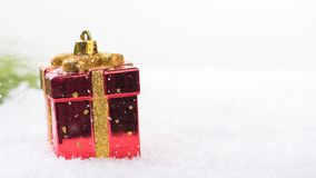 Greeting card with baubles in the snow Stock Images