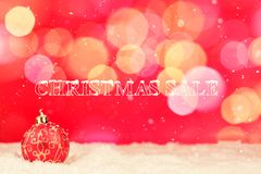 Greeting card with baubles in the snow Royalty Free Stock Photo
