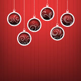 Red Christmas hanging balls on red background Royalty Free Stock Photos