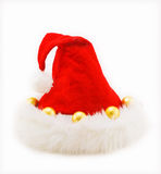 Red Christmas hat with balls on white. Red Christmas hat made of wool with yellow balls on white Royalty Free Stock Images