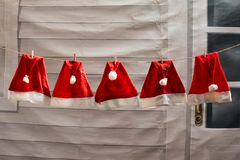 Red Christmas hat drying. Red Christmas hats prepare for coming Christmas and Happy new year. Concept of ready for celebration Royalty Free Stock Photo