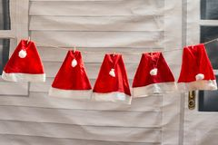 Red Christmas hat drying. Red Christmas hats prepare for coming Christmas and Happy new year. Concept of ready for celebration Royalty Free Stock Image