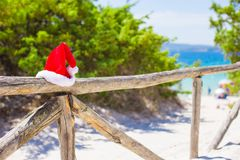 Red christmas hat on on fence background turquoise Royalty Free Stock Photography