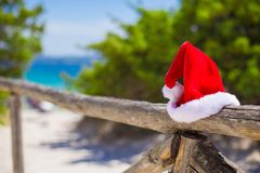 Red christmas hat on on fence background turquoise Royalty Free Stock Photo