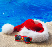 Red christmas hat and sunglasses. royalty free stock image
