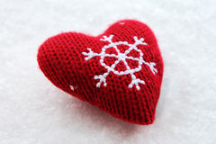 Red Christmas heart on the snow Stock Photo