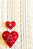 Red christmas hearts on wool Royalty Free Stock Image