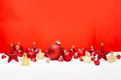 Red christmas holidays decoration on a red background royalty free stock images