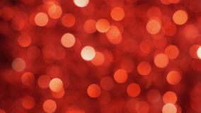 Red Christmas illumination in defocus. Bokeh background. Out of focus
