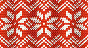 Red Christmas knit vector seamless pattern with white snowflakes and zig zag ornament Royalty Free Stock Image