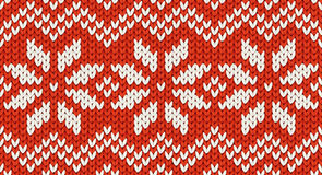 Red Christmas knit vector seamless pattern with white snowflakes and zig zag ornament. Tile Royalty Free Stock Photo