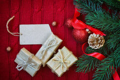 Red Christmas knitted background with three gift box Stock Photography
