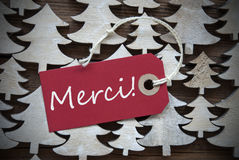 Red Christmas Label With Merci Means Thank You Stock Image