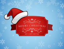 Red Christmas label with Merry Christmas and Happy New Year text. Christmas hat sits on left side Stock Image