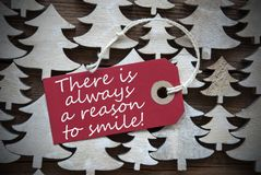 Red Christmas Label With Always Reason To Smile Stock Photos