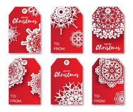 Red Christmas labels with origami white snowflake. Royalty Free Stock Photos