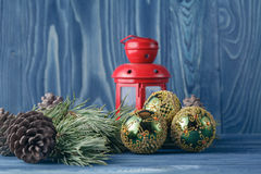 Red Christmas lantern and balls on a wooden table. Christmas tre Stock Images