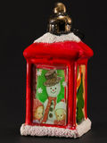 Red christmas lantern with snowman and children decoration Royalty Free Stock Photo