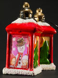 Red christmas lanterns with snowman and children decoration Stock Images