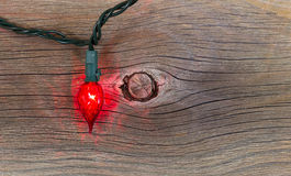 Red Christmas Light on Rustic Wood Stock Images