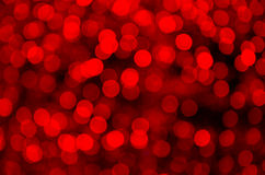 Red Christmas Lights. Background of out of focus red Christmas lights on black Royalty Free Stock Photos