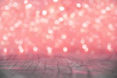 Red Christmas lights blur. Red Christmas lights background with wooden floor Royalty Free Stock Photo