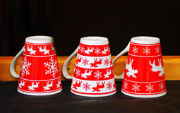 Red christmas mugs Stock Photography