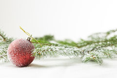 Red christmas or new year ornament on snow Royalty Free Stock Images