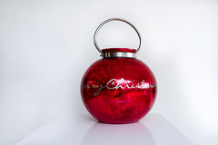 Red Christmas Ornamant. Against white background on white table Royalty Free Stock Photography
