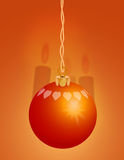 Red Christmas Ornament 1. Red Christmas ornament with red candles in the background Stock Photography