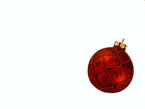 Red Christmas Ornament. A red Christmas tree ornament on a white background Stock Image