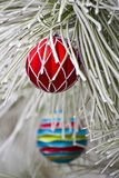 Red Christmas Ornament. Hanging on a frost covered pine tree outdoors with copy space stock images