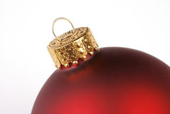 Red Christmas Ornament. Close-up of part of a red Christmas ornament on a white background Royalty Free Stock Image