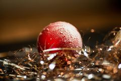 Red Christmas ornament ball with silver and copper fibres Stock Images