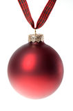 Red Christmas ornament / bauble on plaid ribbon, white backgroun Royalty Free Stock Photography