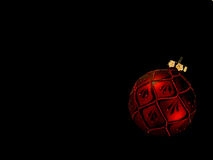Red Christmas Ornament on Black Royalty Free Stock Photography
