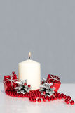 Red Christmas ornament and candle Stock Photography