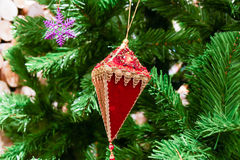 Red christmas ornament decorating on christmas tree. Red and gold christmas ornament decorating on christmas tree Royalty Free Stock Image