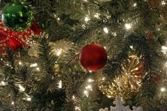 Christmas ornament on tree with lights Royalty Free Stock Photo