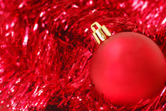 Red Christmas ornament on garland Royalty Free Stock Image