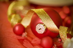 Red Christmas ornament and gold ribbon Stock Photo
