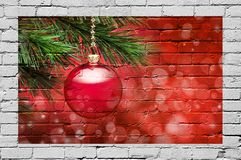 Christmas Tree Ornament Graffiti Background. A red Christmas ornament hanging from a tree painted on a brick wall royalty free stock photos